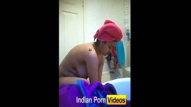 Hidden cam video of girl undressing