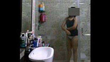 Desi babe taking shower in the hotel bathroom