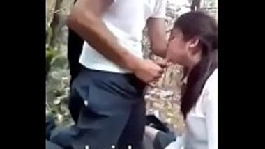 Desi school girl blowjob in the middle of the jungle