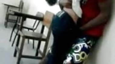 Young India College girl kissing in classroom